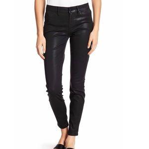 Level 99 mid rise coated skinny black jean